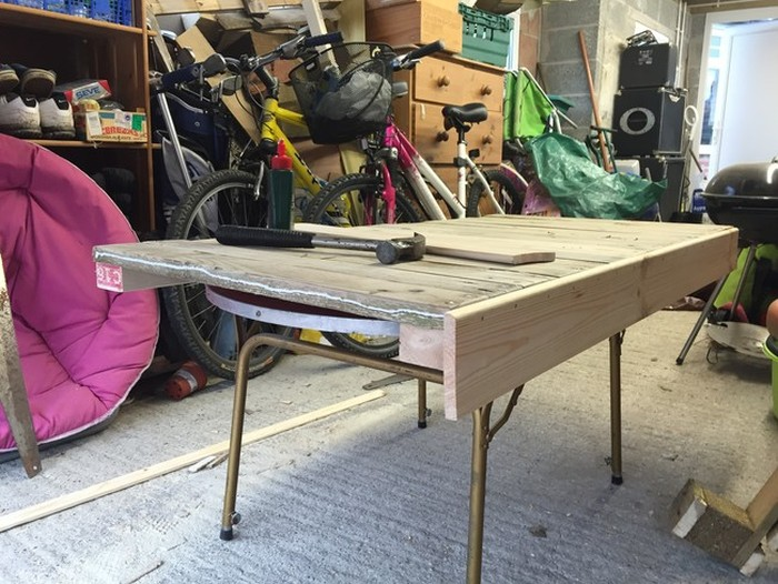 Man Turns Trash Into Treasure With This Pallet Desk