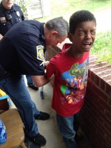 Cops Pretend To Arrest 10 Year Old Boy To Teach Him A Lesson