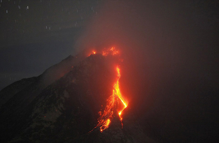 Rumbling Volcano Forces Thousands Of Indonesian Villagers To Leave Their Homes