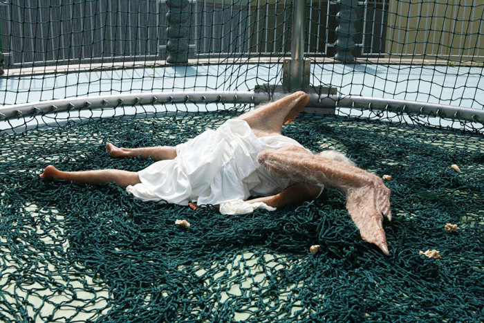 This Realistic Sculpture Of A Fallen Angel Is Absolutely Terrifying