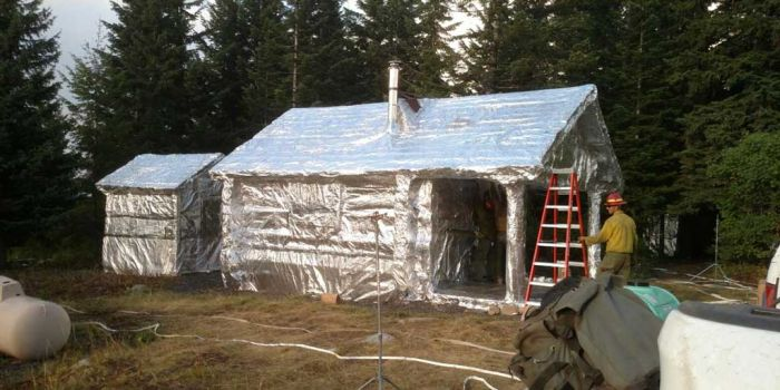 Buildings Wrapped In Tin Foil To Protect Them From Wildfires