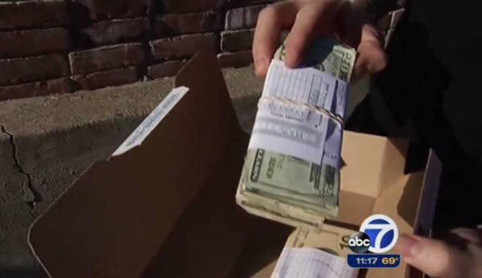 Domino's Driver Accidentally Delivers A Stack Of Cash To A Customer's Door
