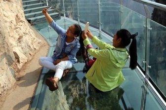 Glass Walkway In China Terrifies Tourists As It Cracks Beneath Their Feet