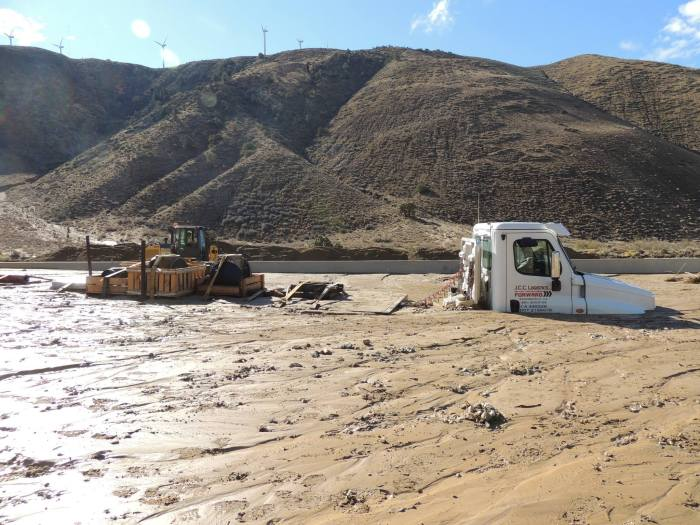 California Highway Workers Try To Uncover Vehicles Trapped In Landslide