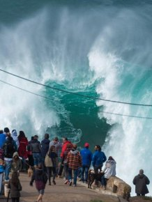 People Watch In Awe As Surfers Ride 100 Foot Waves