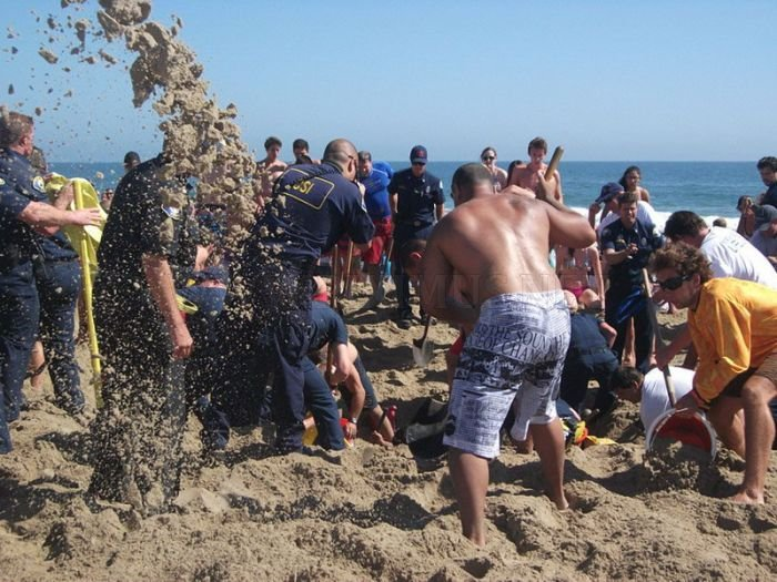 Teen Survives 30 Minutes Buried in Sand