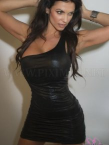 Denise Milani in a Tight Leather Dress