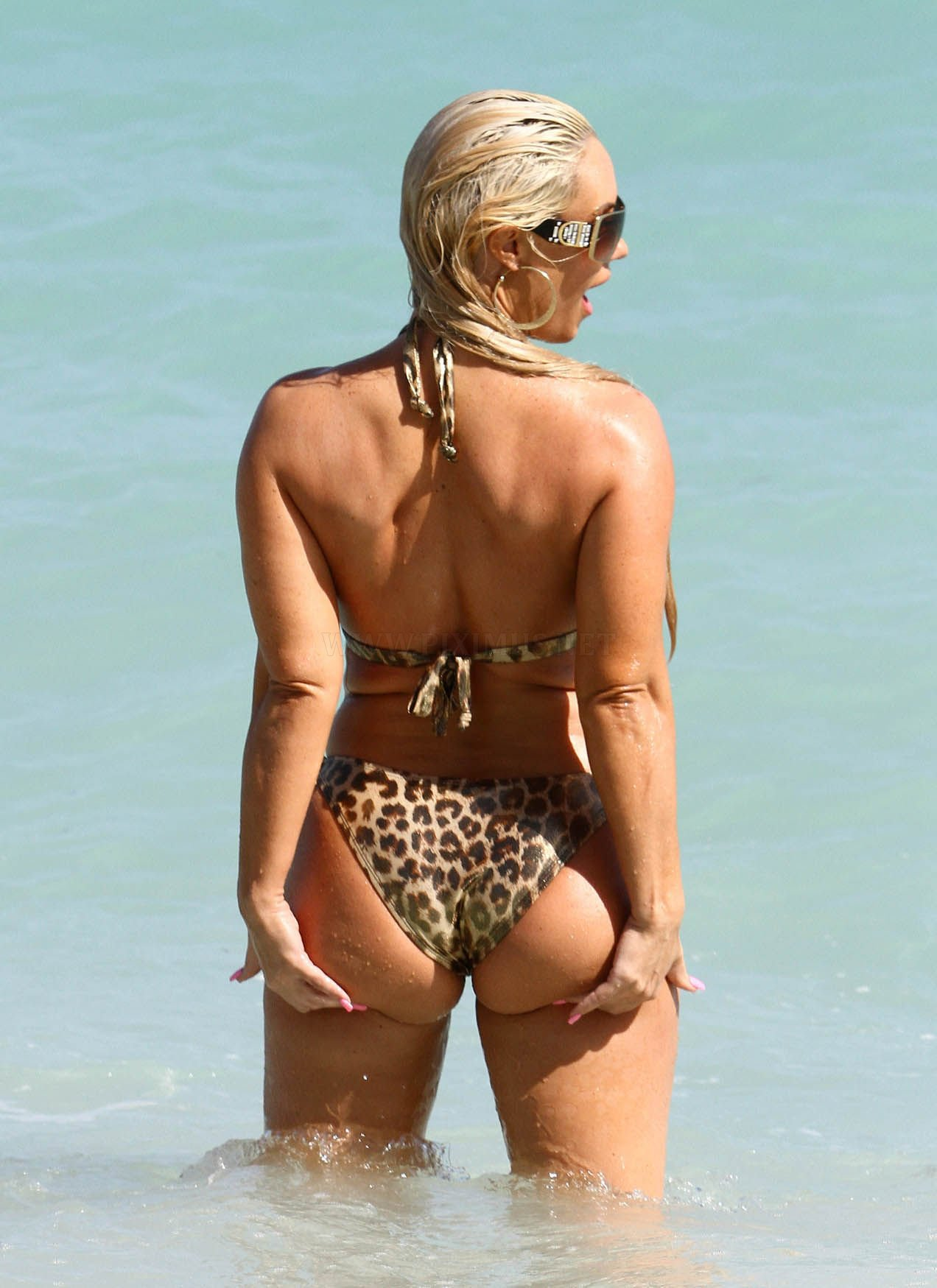 Coco Austin in a Bikini on the Beach