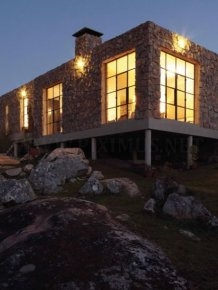 A modern house made from boulders