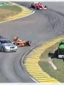 F1 driver NIck Heidfeld hits safety car door