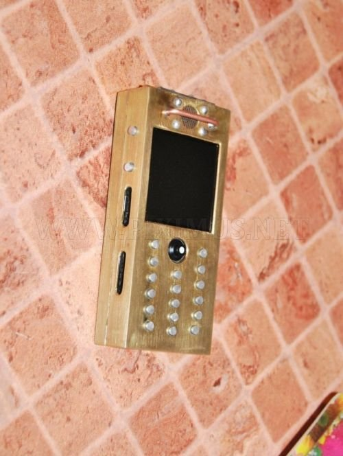 Samsung E590 phone in the style of Steampunk