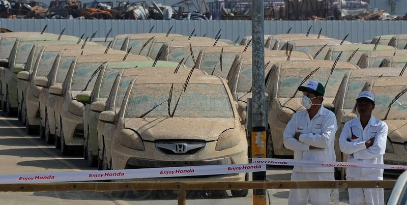 Honda begins scrapping vehicles claimed by Thai flooding