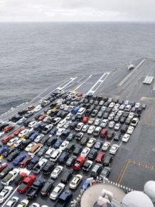 USS Ronald Reagan Transports Cars