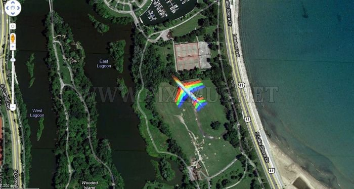 Rainbow plane over Hyde Park in Chicago