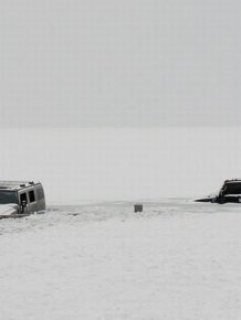 Two Hummers Got Stuck in Frozen Lake