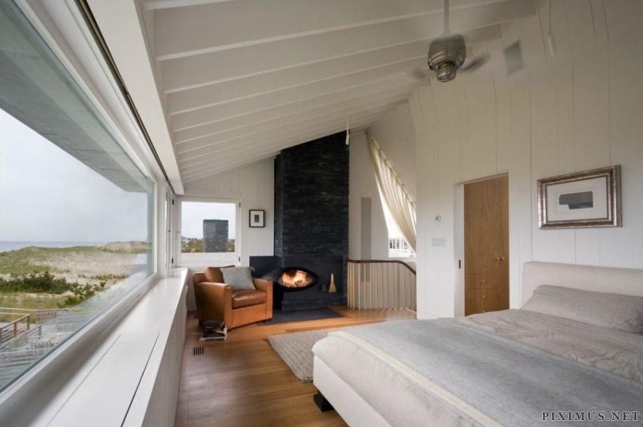 Shingled beach home adds inventive loft on stilts