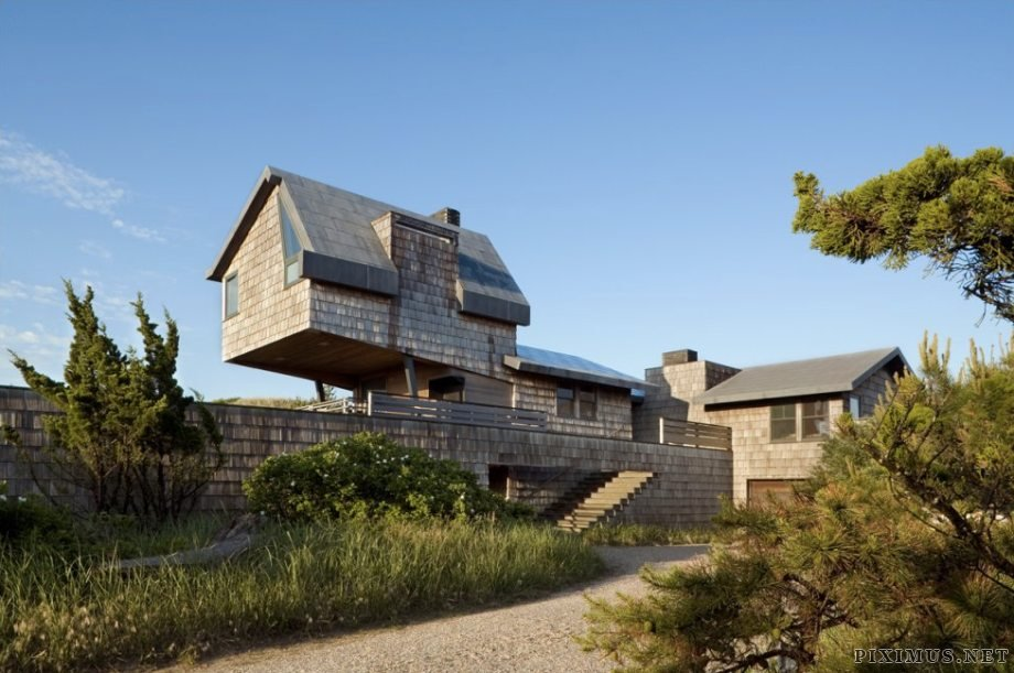 Shingled beach home adds inventive loft on stilts