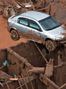 Red Mud Flows Through The Streets Of Brazil