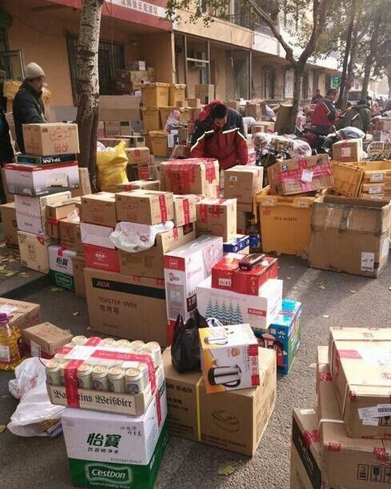 Chinese Mail Workers Get Swamped On This Day Of The Year