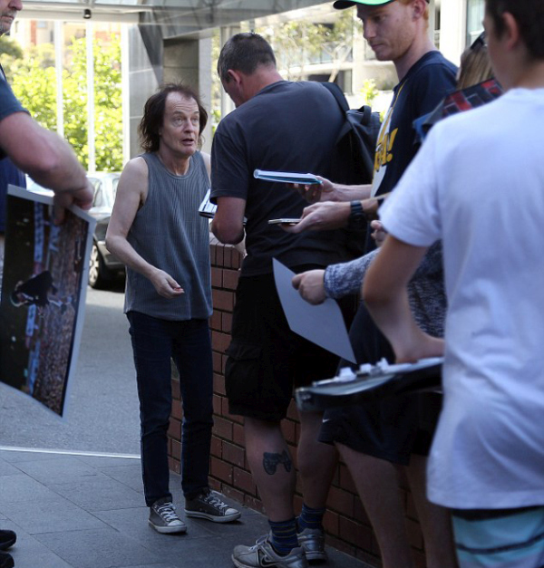 AC/DC Guitarist Angus Young Steps Out To Sign Autographs For Fans