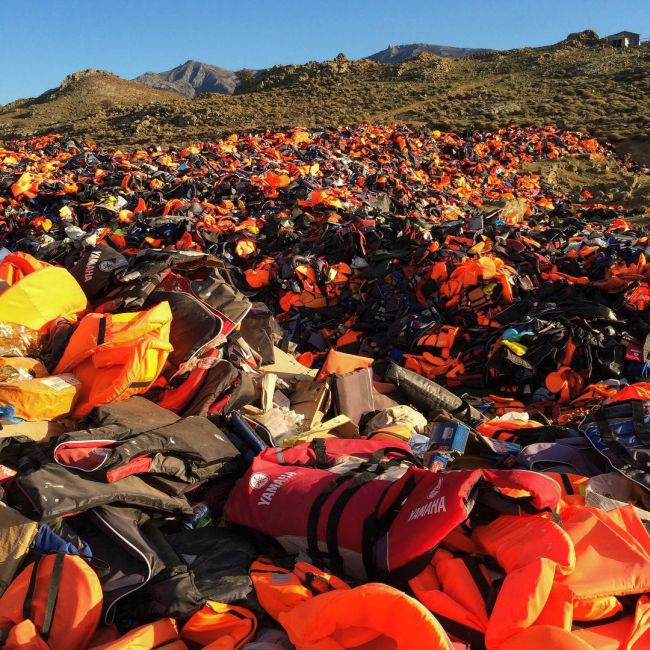 Refugees Use Life Jackets To Display A Message Of Peace On A Greek island