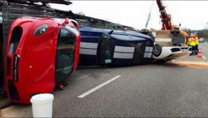 Transporter Carrying Supercars Overturns On The Road Vehicles