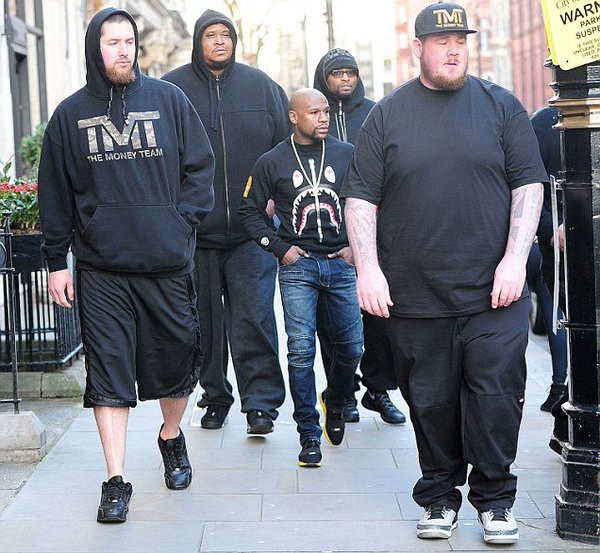 Floyd Mayweather's Bodyguards Make Him Look Like A Little Kid