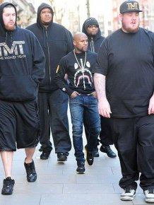 Floyd Mayweather's Bodyguards Make Him Look Like A Little Kid