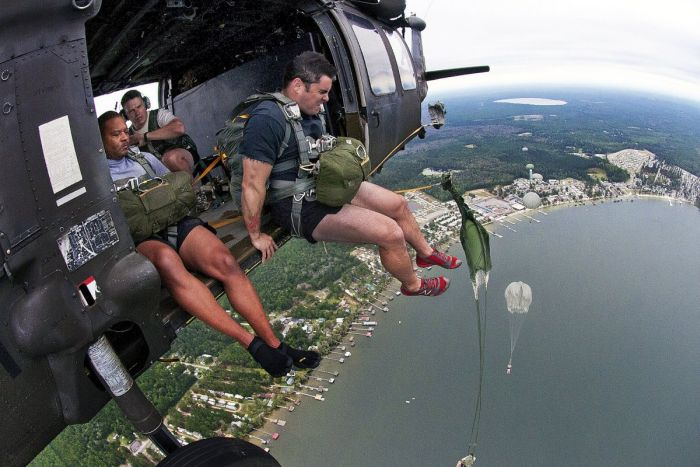 US Marines Jump Out Of A Plane And Into Action