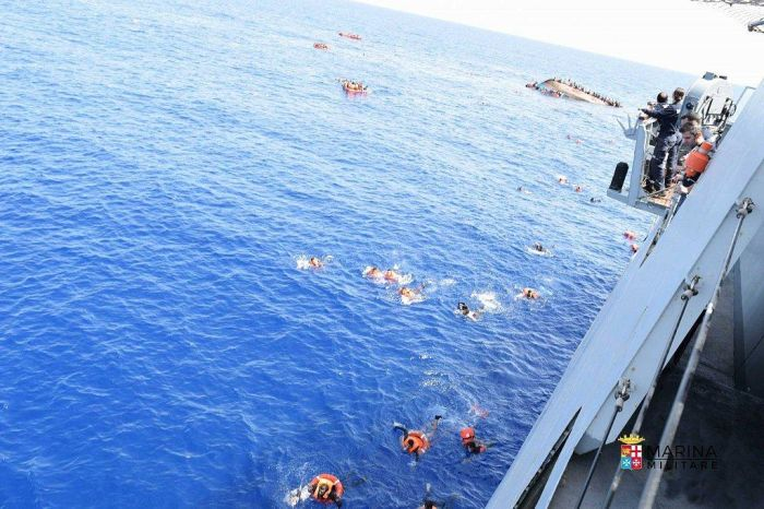 Italian Navy Rescues Migrants After Their Boat Reaches A Tipping Point