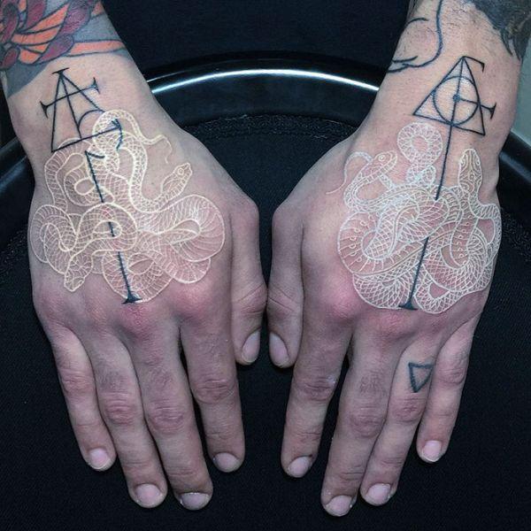 Mirko Sata Creates The Coolest Black And White Snake Tattoos