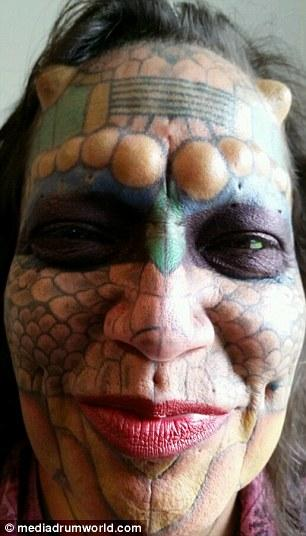 Former Bank Employee Modifies Their Body To Look More Like A Dragon
