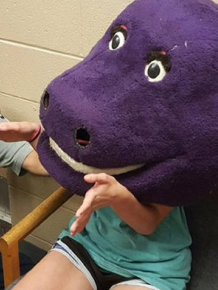 Young Girl Gets Stuck In A Barney The Purple Dinosaur Costume