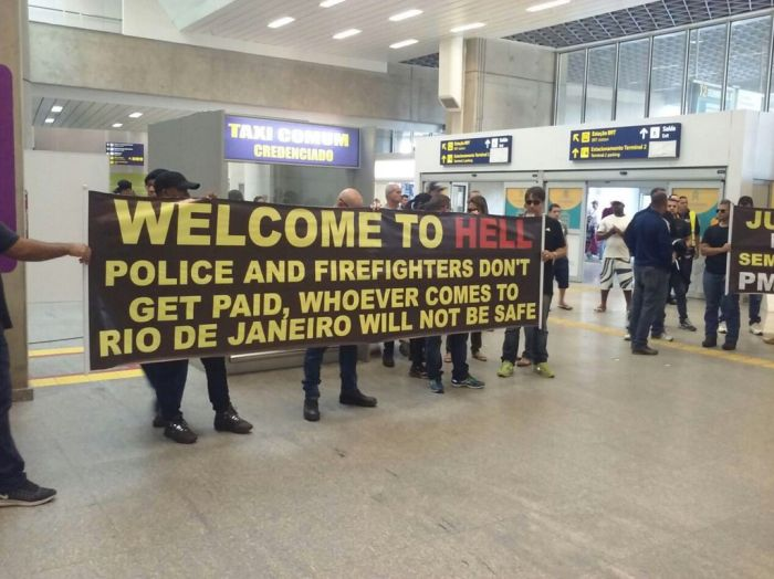 Citizens Of Rio Greet Visitors With A Welcome To Hell Banner