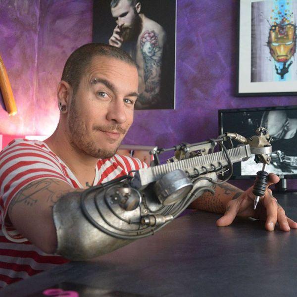 Tattoo Artist Gets First Ever Tattoo Gun Prosthetic