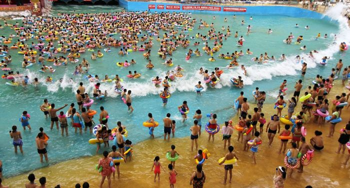 Thousands Of Tourists Gather In China's Largest Indoor Swimming Pool