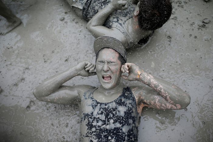 People Let Loose And Get Dirty At The South Korea Mud Festival