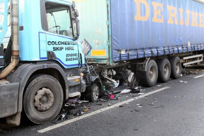 Driver Somehow Survives After Being Crushed Between Two Trucks