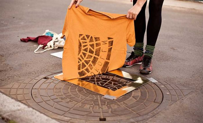 berlin artists create designer clothes using manhole