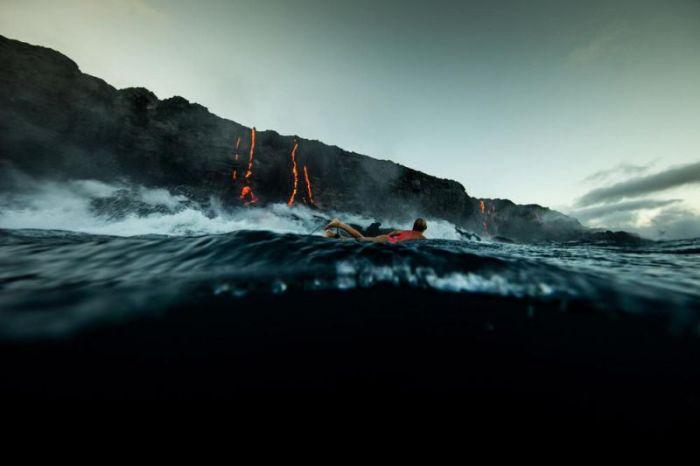 Adventurous Surfer Swims Near Erupting Volcano In Hawaii