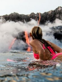 Adventurous Surfer Swims Near Erupting Volcano In Hawaii