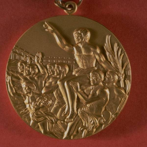 A Look Back At How Olympic Gold Medal Designs Have Changed Over The Years