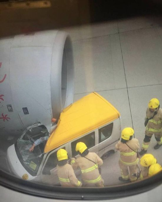 Hong Kong Plane Crushes Service Van On Airport Runway