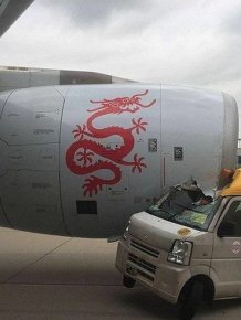 Hong Kong Plane Crushes Service Van On Airport Runway