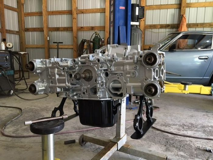 Guy Turns His Smashed Car's Engine Into An Epic Coffee Table