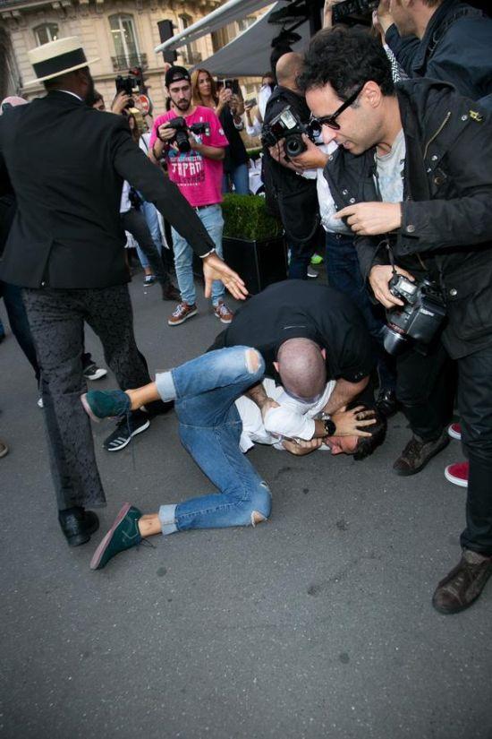 Ukranian Guy Gets Busted For Trying To Kiss Kim Kardashian's Ass