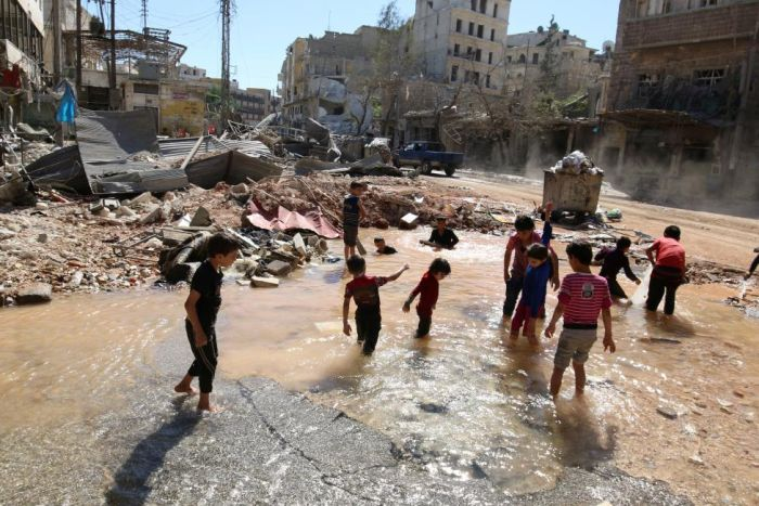 Chrildren Play With Water In A War Zone