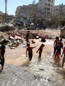 Chrildren Play With Water In A War Zone