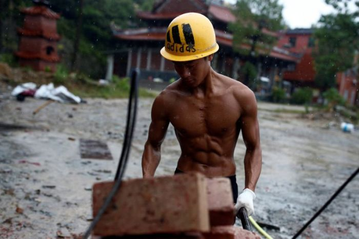 Handyman At Buddhist Temple Constantly Trains On The Job