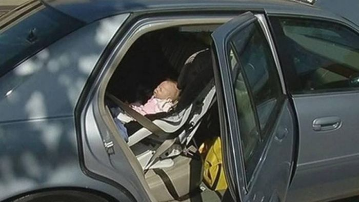 Cop Gets A Surprise When He Breaks Into A Car To Rescue A Baby